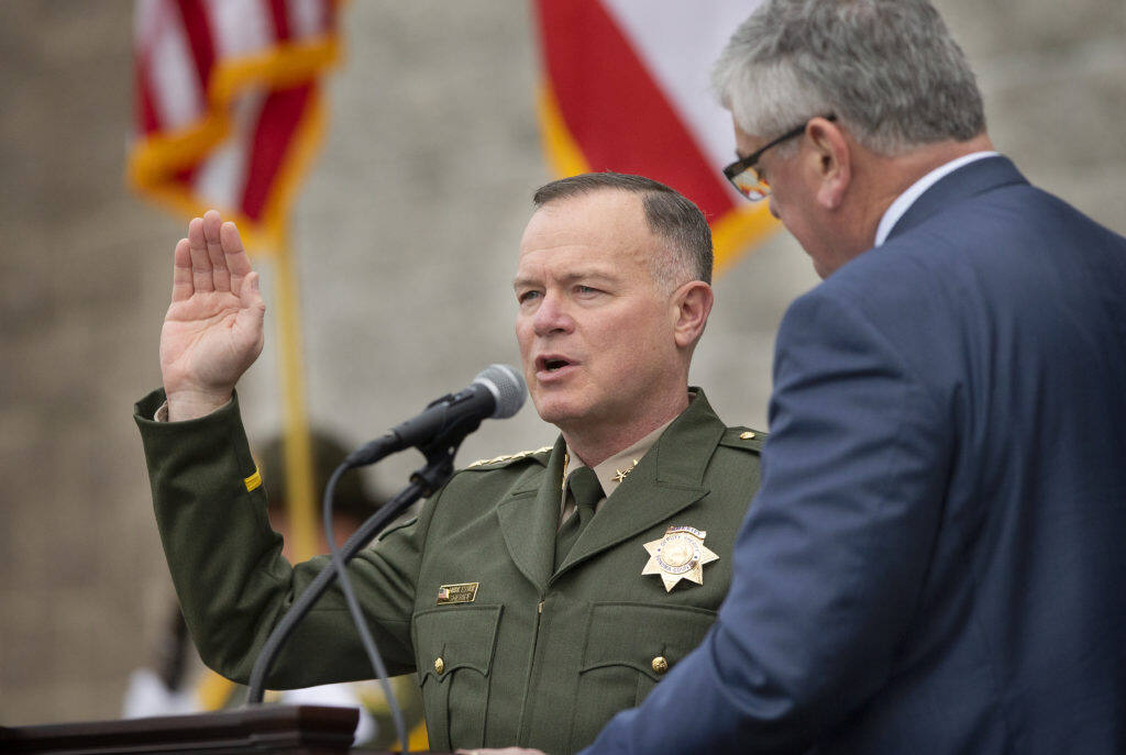 Supervisor David Rabbitt swears in elected Sonoma County Sheriff Mark Essick in January 2019. (John Burgess / The Press Democrat)