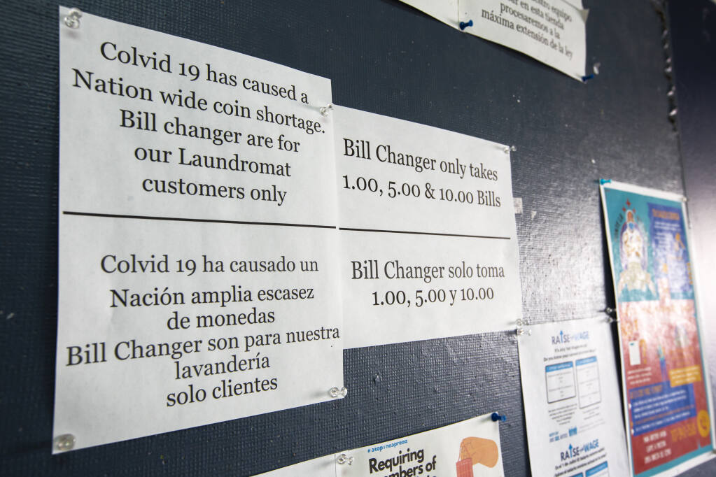 The Econo Wash Laundromat at the Vineyard Center on Highway 12 stresses that 'bill changers are for our laundromat customers only,' to keep empty-pocketed residents and businesses from raiding their change machines. (Photo by Robbi Pengelly/Index-Tribune)