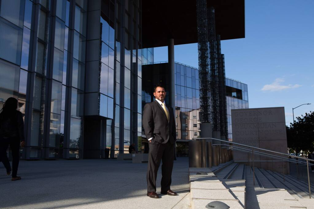 James Binnall had served prison time after a homicide conviction for driving drunk as a 23-year-old graduate student in 1999, crashing his car and killing his friend and passenger. While on parole, he went to Thomas Jefferson School of Law, graduating and maxing-out his seven-year sentence the same week. But he learned the day of his jury summons in 2009 that California prohibits former felons for life from serving on juries. (James Bernal for Calmatters)