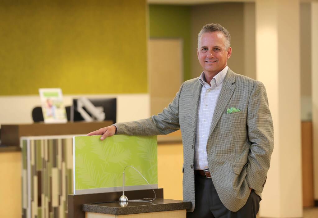 Redwood Credit Union President and CEO Brett Martinez at the newly refurbished N. Dutton Ave. location in Santa Rosa on Tuesday, August 20, 2019. (BETH SCHLANKER/ The Press Democrat)