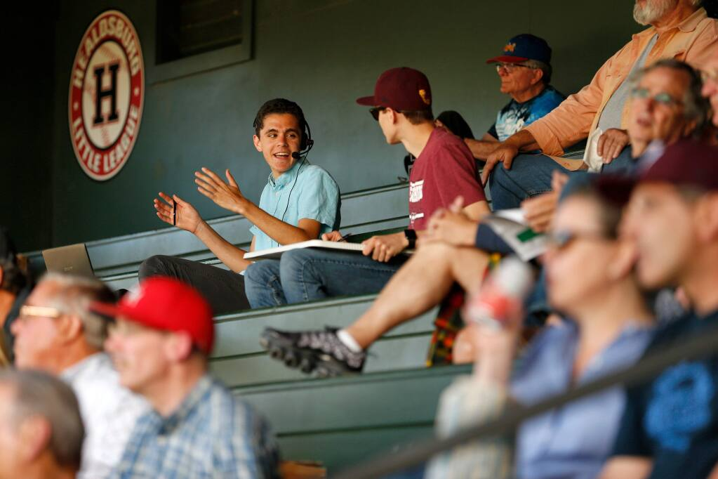 Griffin Epstein, upper left, banters with his friend and stats keeper Lucas Rumpler while calling the play-by-play action for streaming audio over the internet for a Healdsburg Prune Packers baseball game against the Humboldt Crabs, in Healdsburg, California, on Thursday, June 20, 2019. (Alvin Jornada / The Press Democrat)