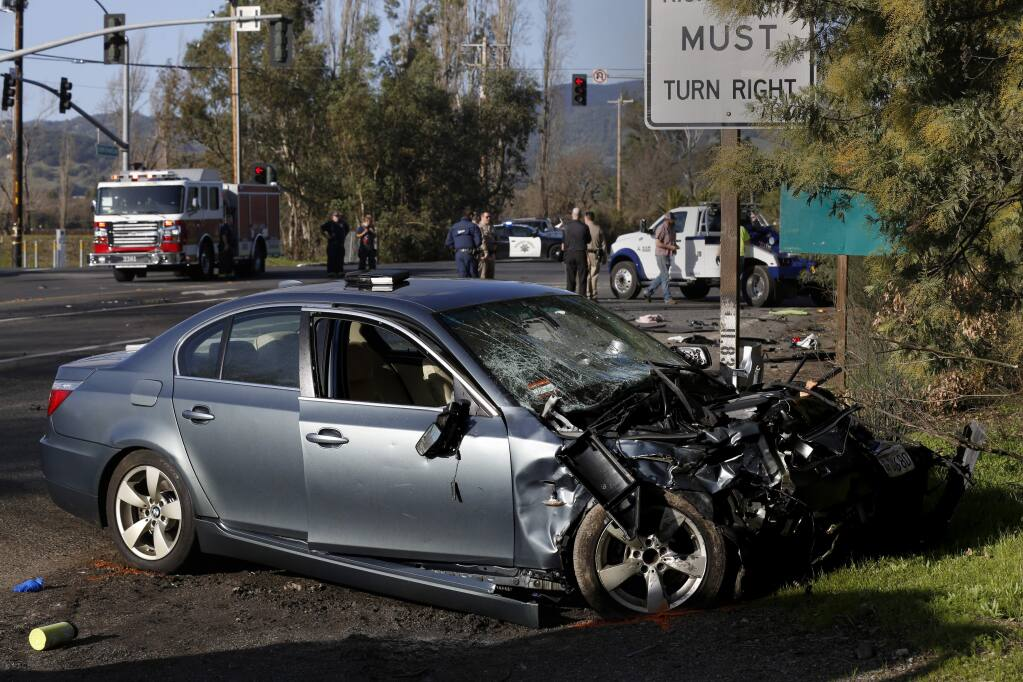 Emergency workers respond to the scene of a fatal accident after an alleged drunk driver of a BMW ran a red light killing the 35-year-old male driver of a Subaru and seriously injuring passenger 34-year-old Natalie Weiss at 8th Street and East Napa Rd. in Sonoma on Sunday, January 26, 2020. (BETH SCHLANKER/ The Press Democrat)