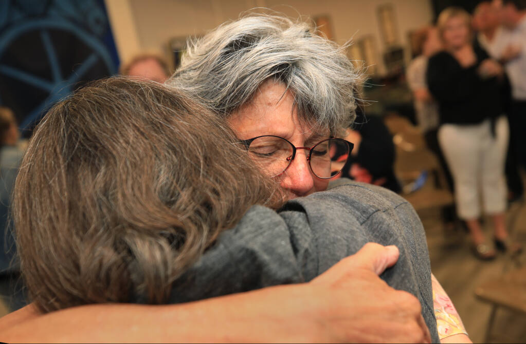 Sonoma County District Attorney Jill Ravitch, right, embraces her sister Amy Friedricks as she reacts after garnering 80% of the early returns in her recall election, Tuesday, Sept. 14, 2021 in Santa Rosa. (Kent Porter / The Press Democrat) 2021