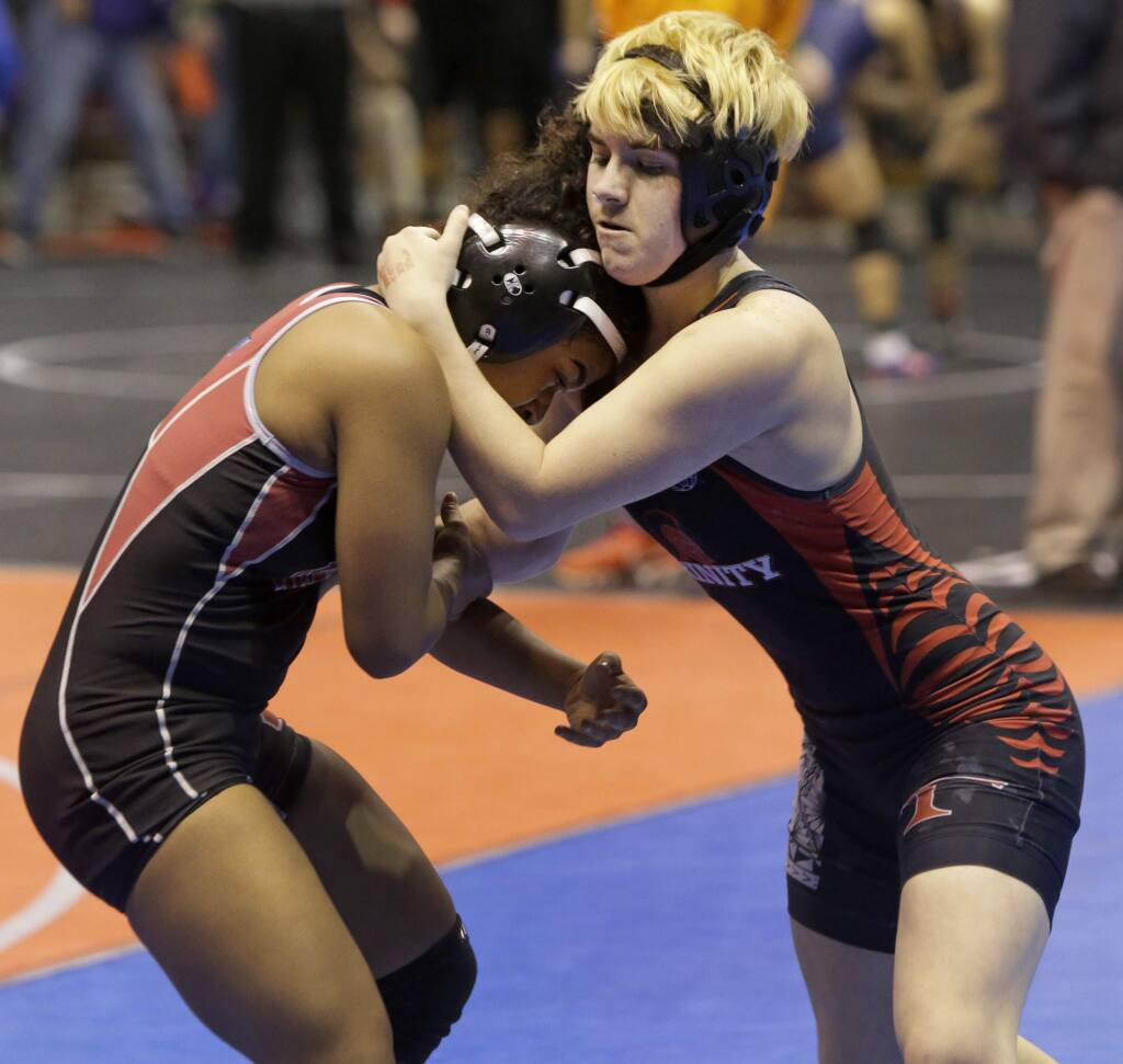 Mack Beggs, right, a wrestler from Trinity High in Euless, competes in a quarterfinal match against Mya Engert of Tascosa High in Amarillo during the Texas state wrestling tournament on Friday in Cypress, Texas. Beggs was born a female and is transitioning to male but has beenis required to wrestle in the girls division. (Melissa Phillip/Houston Chronicle via AP)