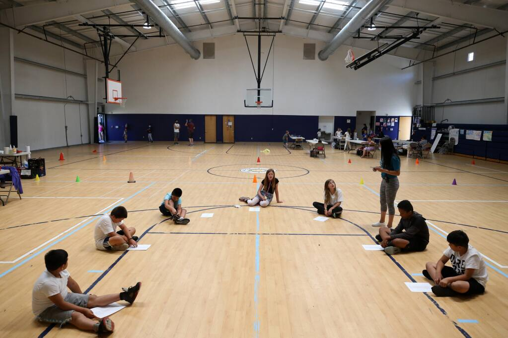 "Members of the green group practice singing ""Old Town Road"" at the Boys and Girls Club summer camp at Windsor Middle School in Windsor, on Thursday, July 30, 2020. (Beth Schlanker / The Press Democrat)"