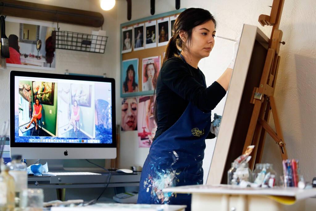 Dayana León pinta un cuadro en el estudio de su casa en Santa Rosa. Alvin Jornada / The Press Democrat