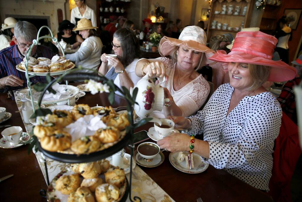 Kimberly Coenen pours tea for Andrea Christensen, right, during a Mary Poppins Holiday Tea Party at The Tudor Rose English Tea Room in Santa Rosa, on Sunday, December 17, 2017. (BETH SCHLANKER/ The Press Democrat)