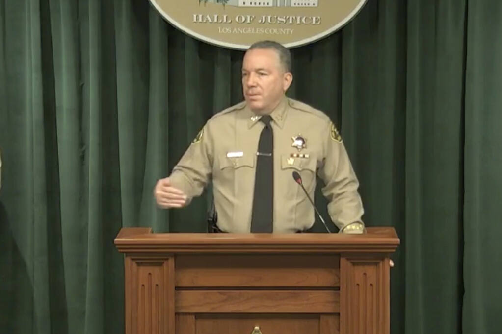 In this image take from a livestream video feed provided by the Los Angeles County Sheriff's Department, Sheriff Alex Villanueva speaks during a news conference in Los Angeles, Wednesday, April 7, 2021, about the Tiger Woods' accident. Authorities say Woods was speeding when he crashed an SUV in Southern California less than two months ago, leaving him seriously injured. (Los Angeles County Sheriff's Department via AP)