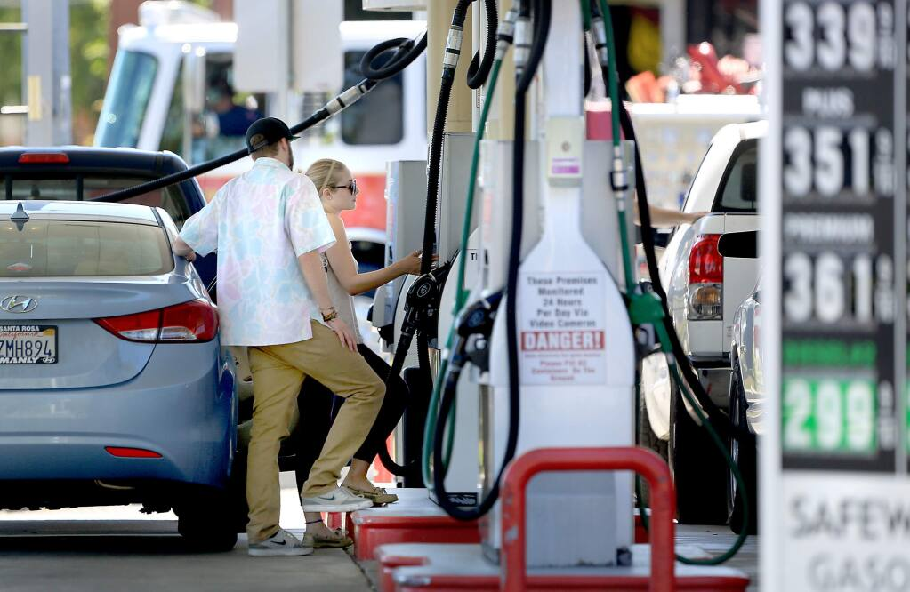 Customers buy fuel at the Safeway gas station in Santa Rosa, Tuesday July 14, 2015 in Santa Rosa. (Kent Porter / Press Democrat) 2015