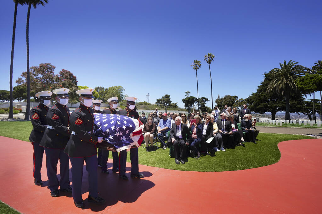 A military honor guard escorts the casket of Marine Corps, Pfc. John Franklin Middleswart for a full military honors at Fort Rosecrans National Cemetery, on Tuesday, June 8, 2021 in San Diego. Eighty years after he died in the attack on Pearl Harbor and just months after his remains were finally identified, the California Marine has been laid to rest with full military honors. About 50 people attended the ceremony Tuesday in his hometown of San Diego, the Union-Tribune reported. (Nelvin C. Cepeda/The San Diego Union-Tribune via AP)