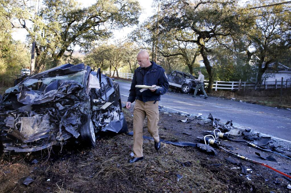 CHP Lieutenant Ken Roberts investigates the scene of a head-on collision on Highway 12 that killed a woman driver and critically injured a child and another driver in Agua Caliente, on Tuesday, Nov. 14, 2017. (BETH SCHLANKER/ PD)