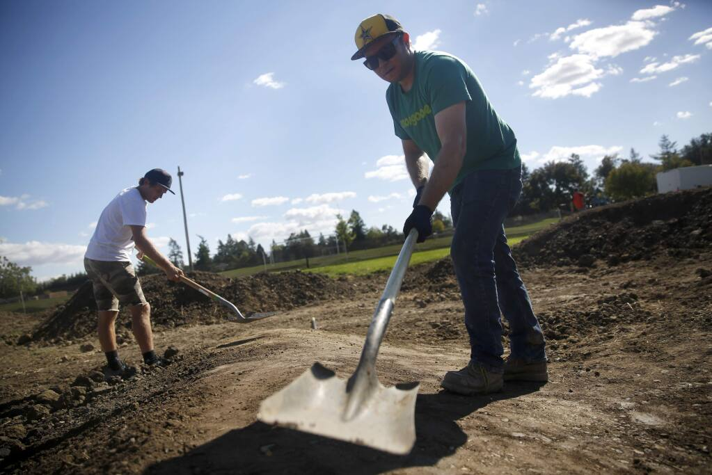 Greg Watts, right, and Andrew Taylor work to build a pump track at Northwest Community Park on Tuesday, Oct. 4, 2016 in Santa Rosa. (BETH SCHLANKER/ The Press Democrat)
