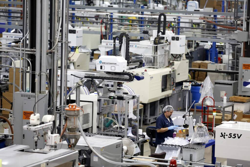 Elias Gomez Mora works on the manufacturing floor at Labcon on Monday, October 6, 2014 near Petaluma, California. (BETH SCHLANKER/ The Press Democrat)