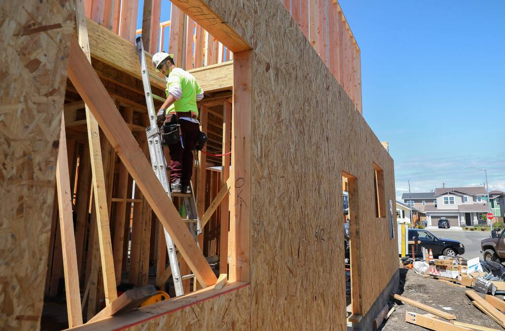 Matteo Gonzalez works on a home under construction on Jessica Place, in Santa Rosa on Tuesday, April 7, 2020. (Christopher Chung/ The Press Democrat)