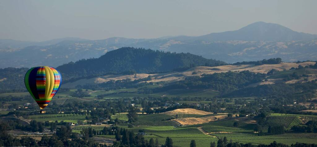 Geyser Peak and vineyards north of Windsor serve as a backdrop for the Sonoma County Hot Air Balloon Classic in Windsor in 2018. Sonoma County Tourism in a Feb. 24, 2021, virtual town hall laid out plans for the region's recovery as coronavirus conditions improve and travel restrictions ease. (Kent Porter / The Press Democrat) 2018