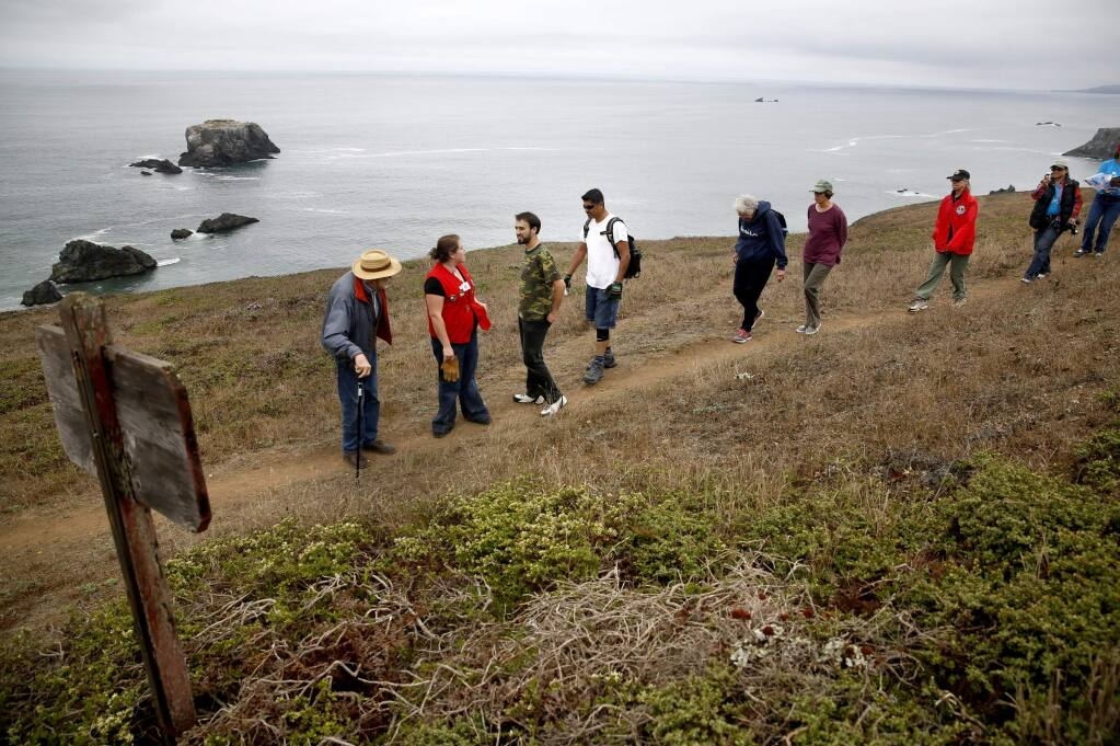 Coastal conservationist Bill Kortum, left, and his family met with members of an all-Spanish speaking Lions Club from the Roseland area at the head of Kortum Trail on Saturday, September 20, 2014 near Jenner, California. (BETH SCHLANKER/ The Press Democrat)