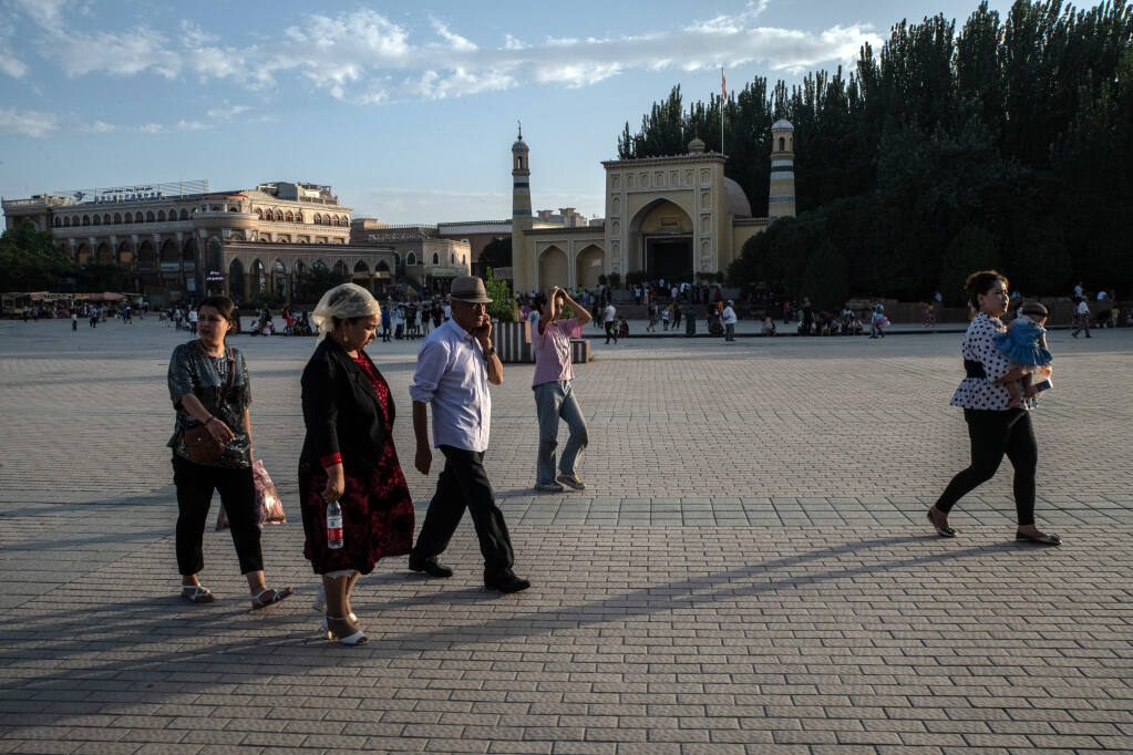 People outside the Id Kah Mosque in Kashgar in the Xinjiang region of China on Aug. 7, 2019. A movie is part of Beijing's wide-ranging new propaganda campaign to push back on sanctions and criticism of its oppression of the Uyghurs. (The New York Times/Giles Sabrie)