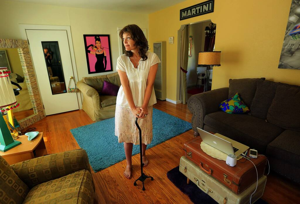 (FILE PHOTO) Christine Webster is being forced out of her Healdsburg home after 10 years because the landlord is raising her rent by 65 percent. Webster, who suffered a stroke 8 years ago and lives on a fixed income, can't afford the increase. (JOHN BURGESS / The Press Democrat) 2015