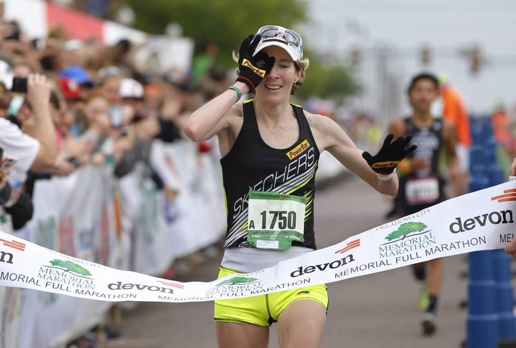 Camille Herron crosses the finish line of the 15th annual Oklahoma City Memorial Marathon for her third win in the women's division of the event in Oklahoma City, Sunday, April 26, 2015. Herron will race in the Lake Sonoma 50 on Saturday, April 13, 2019. (AP Photo/Sue Ogrocki)