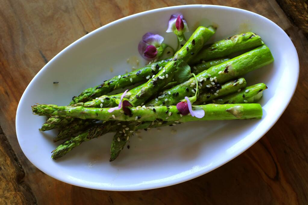 Roasted asparagus with miso dressing and toasted sesame seeds from the Spinster Sisters in the South A district of Santa Rosa. (Photo by John Burgess)