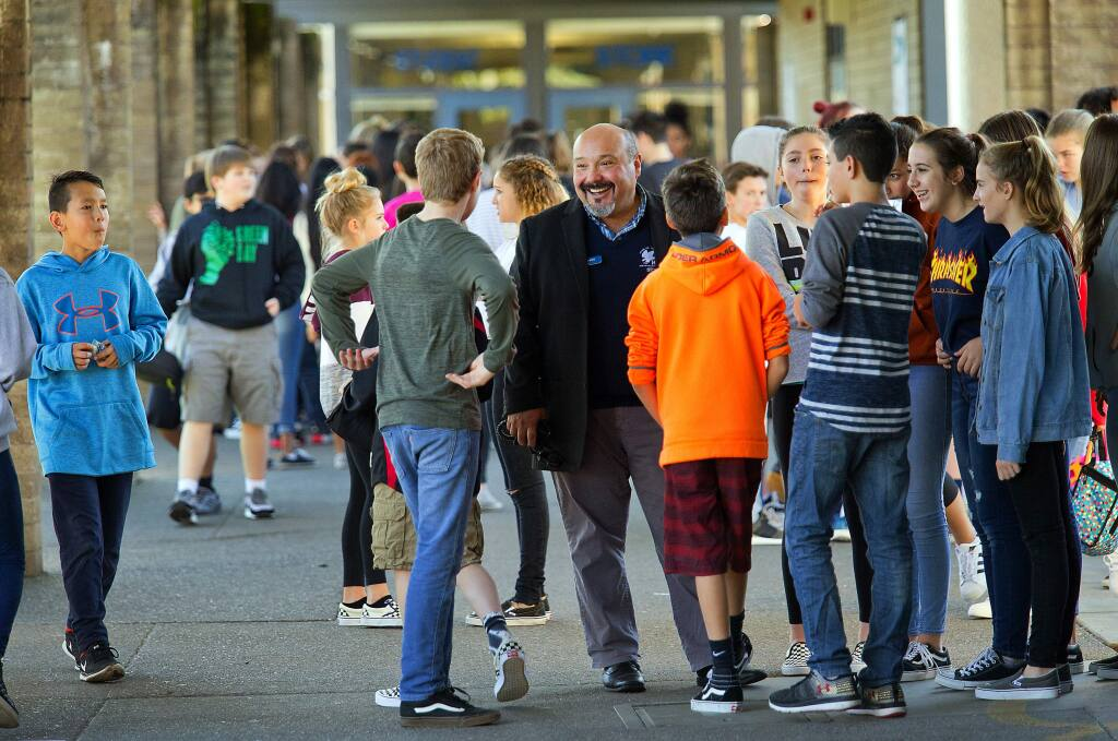 John Burgess / The Press DemocratRincon Valley Middle School and Santa Rosa Accelerated Charter Principal Ed Navarro talks with students during lunch Friday.