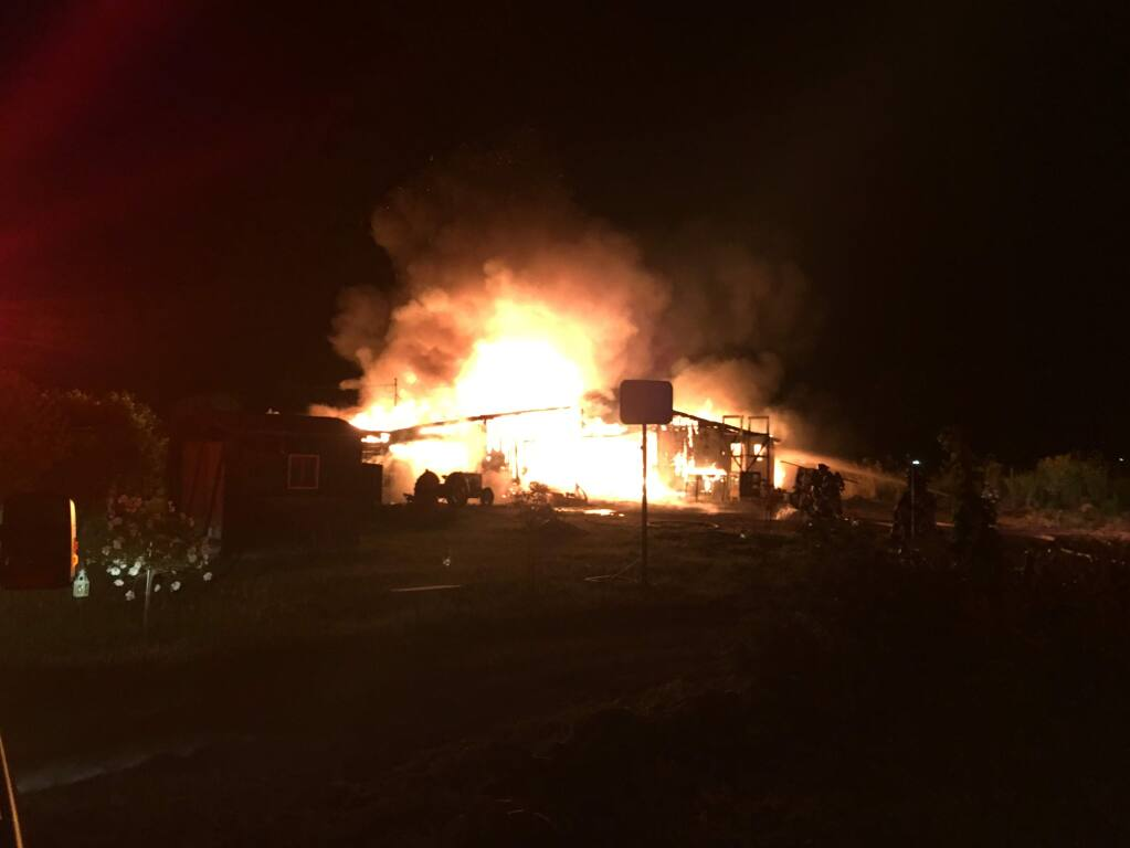 A fire consumed a barn and two cars in Penngrove on Tuesday, May 16, 2017. (COURTESY OF RANCHO ADOBE FIRE)