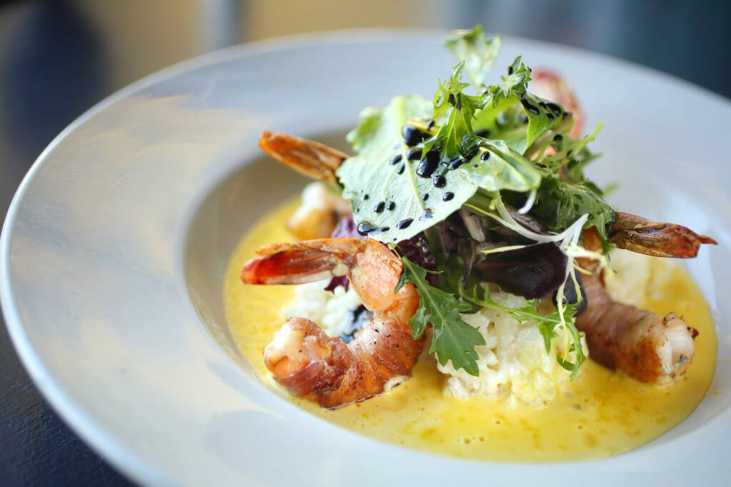 Pancetta wrapped grilled prawns on risotto with saffron cream sauce is served at Bruno's on Fourth in Santa Rosa on Wednesday, January 22, 2014. (Conner Jay/The Press Democrat)