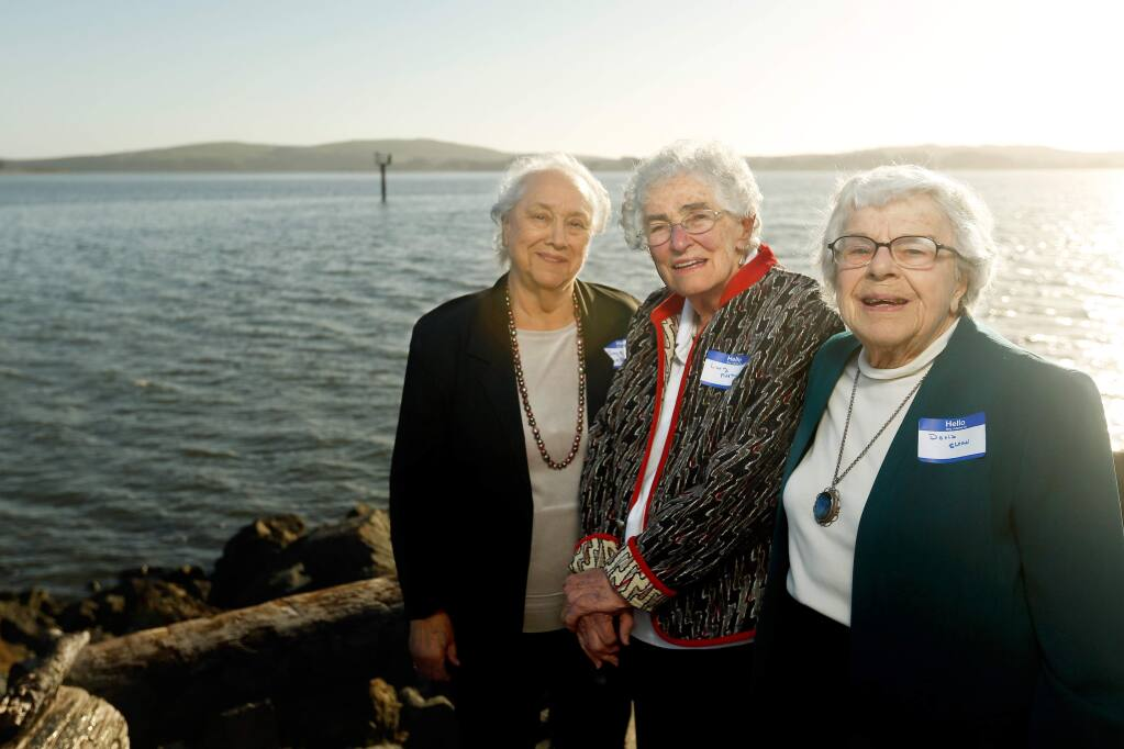 From left, Gaye LeBaron, Lucy Kortum and Doris Sloan pose for a portrait with Bodega Head behind them, in Bodega Bay, California, on Wednesday, May 2, 2018. The three women are being honored by the California Coastal Trail Association for their historic roles in the conservation of the North Coast. (Alvin Jornada / The Press Democrat)