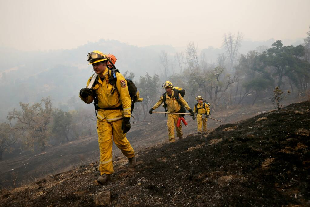 Cal Fire firefighters return from combating the Kincade fire along Coyote Ridge Road in Geyserville on Oct. 24, 2019. (BETH SCHLANKER/ PD)