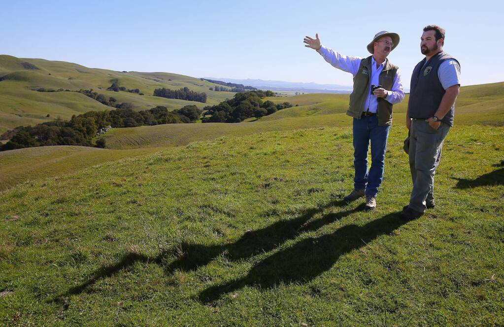 Sonoma Land Trust stewardship director Bob Neale, left, talks with Sonoma County Regional Parks maintenance worker Korey Gosselin as they look over the 1665-acre Tolay Creek Ranch property that the Sonoma Land Trust is donating to Sonoma County Regional Parks, near Petaluma on Thursday, March 2, 2017. The donation nearly doubles the size of Tolay Lake Regional Park.(Christopher Chung/ The Press Democrat)