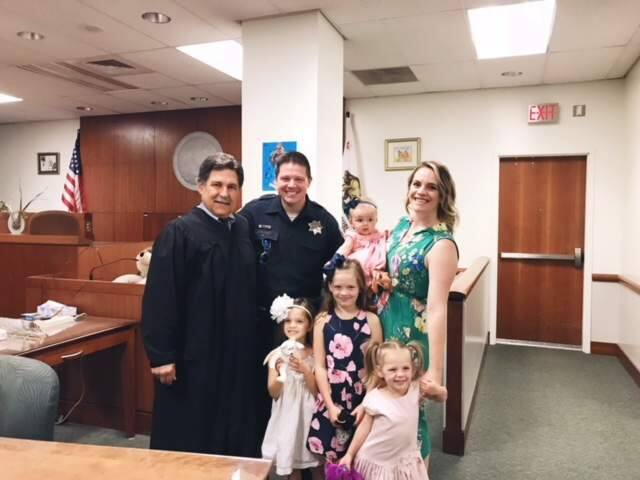 At back from left, Judge Ken Gnoss, SRPD officer Jesse Whitten and his wife, Ashley, who is holding their new adopted baby, Harlow. In front, from left, Kendall, 5, Reece, 7, and Stella, 3. (Jesse Whitten)