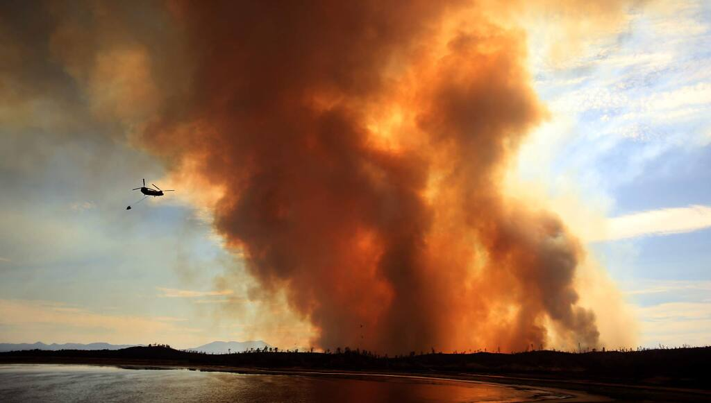 The Jerusalem fire flares up just below the now closed Homestake Mine on Morgan Valley Road, Monday Aug. 10, 2015. (Kent Porter / Press Democrat) 2015