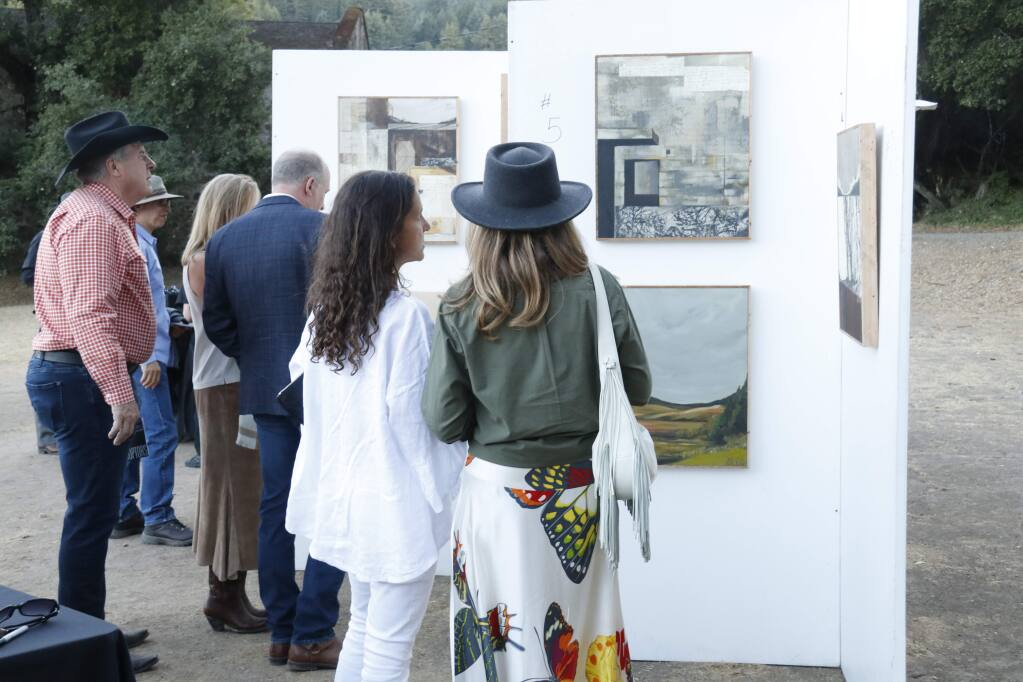 Viewing the artwork on sale at the Jack London State Park gala, Sept. 21, 2019. (Christian Kallen/Index-Tribune)