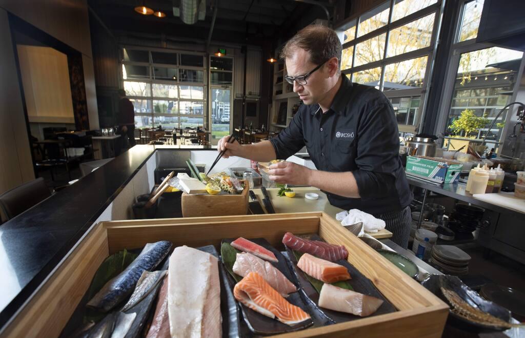 Sushi Kosho chef/owner Jake Rand prepares a Chef's Choice Seasonal Sashimi at the restaurant in Sebastopol's Barlow. (photo by John Burgess/The Press Democrat)