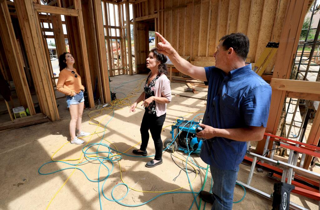 George and Regina Cuculich, tour their home being rebuilt, Friday, April 19, 2019. Daughter Claire Raggio, is at left. The home was destroyed during the Tubbs fire as it swept over Fountaingrove in October 2017 and is being constructed by the Urban Building Group. (Kent Porter / The Press Democrat) 2019