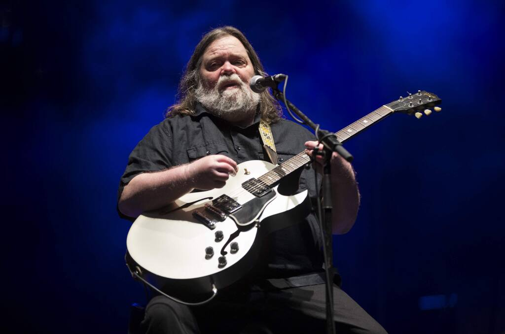 In this March 17, 2018 photo, Roky Erickson performs at the South by Southwest Music Festival in Austin, Texas. Erickson, the blue-eyed, dark-haired Texan who headed the Austin-based 13th Floor Elevators, a pioneering psychedelic rock band in the 1960s that scored with 'You're Gonna Miss Me,' has died, Friday, May 31, 2019. He was 71. (Jay Janner/Austin American-Statesman via AP)