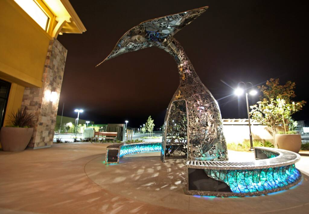 A 15-foot-tall whale tail, created from scrap metal by Sacramento artist Terrence Martin, was recently installed at the Deer Creek Village shopping center, the first development to include its own piece of art instead of paying into the city's Public Art Fund. (ALLISON JARRELL/ARGUS-COURIER STAFF)
