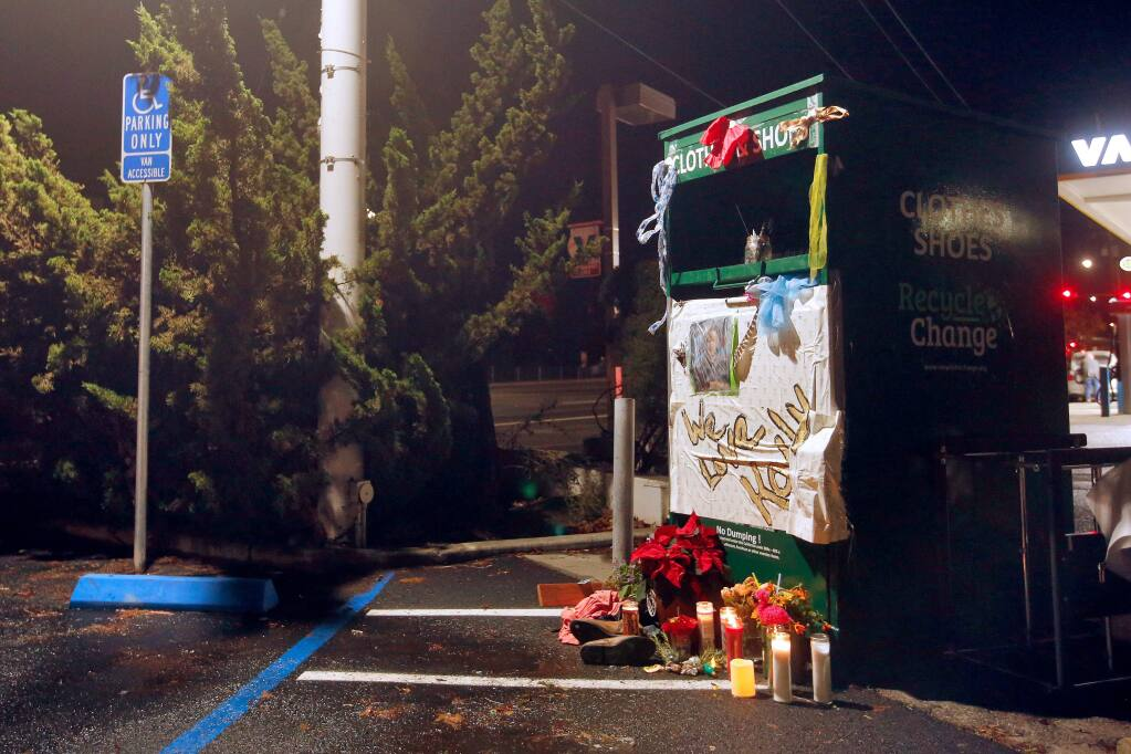 A items forming a makeshift memorial for Kaily Land are seen at clothing donation box where Land died, off Old Redwood Highway North in Petaluma, California, on Thursday, November 29, 2018. (Alvin Jornada / The Press Democrat)
