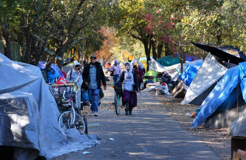 A homeless encampment lines both sides of the Joe Rodota Trail, west of Stony Point Road, in Santa Rosa on Tuesday, Nov. 19, 2019. (CHRISTOPHER CHUNG/ PD)