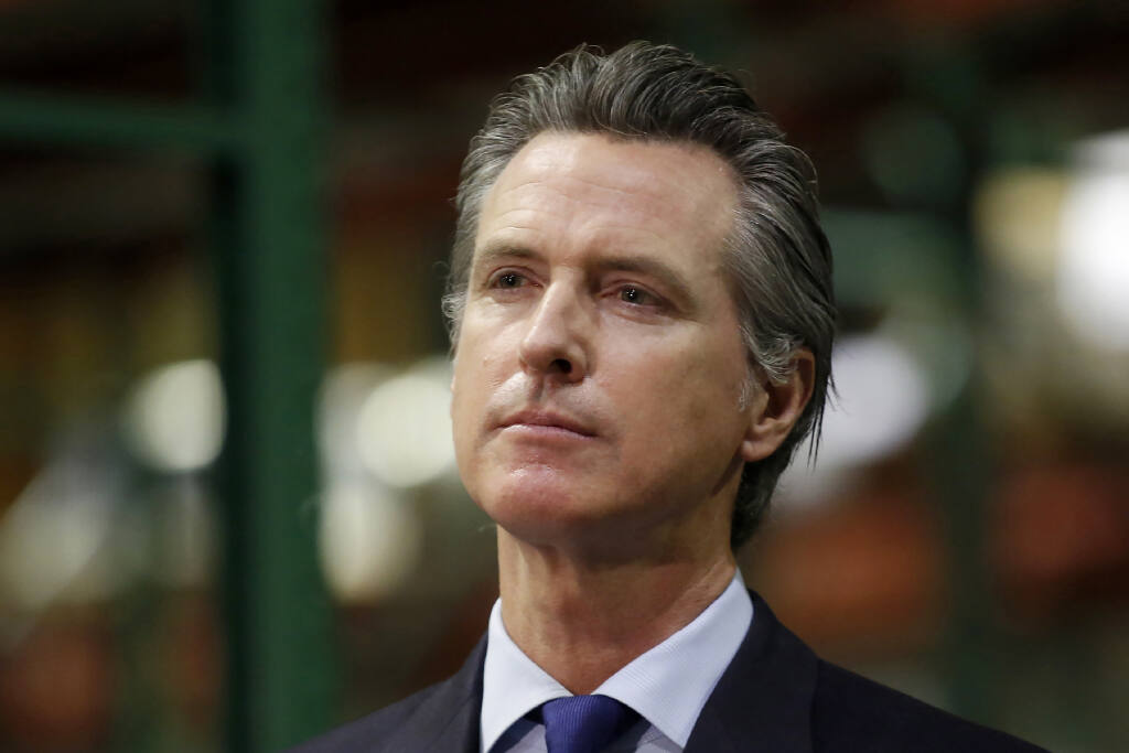 FILE - In this June 6, 2020, file photo, California Gov. Gavin Newsom listens to a reporter's question during a news conference in Rancho Cordova, Calif.  (AP Photo/Rich Pedroncelli, Pool, File)