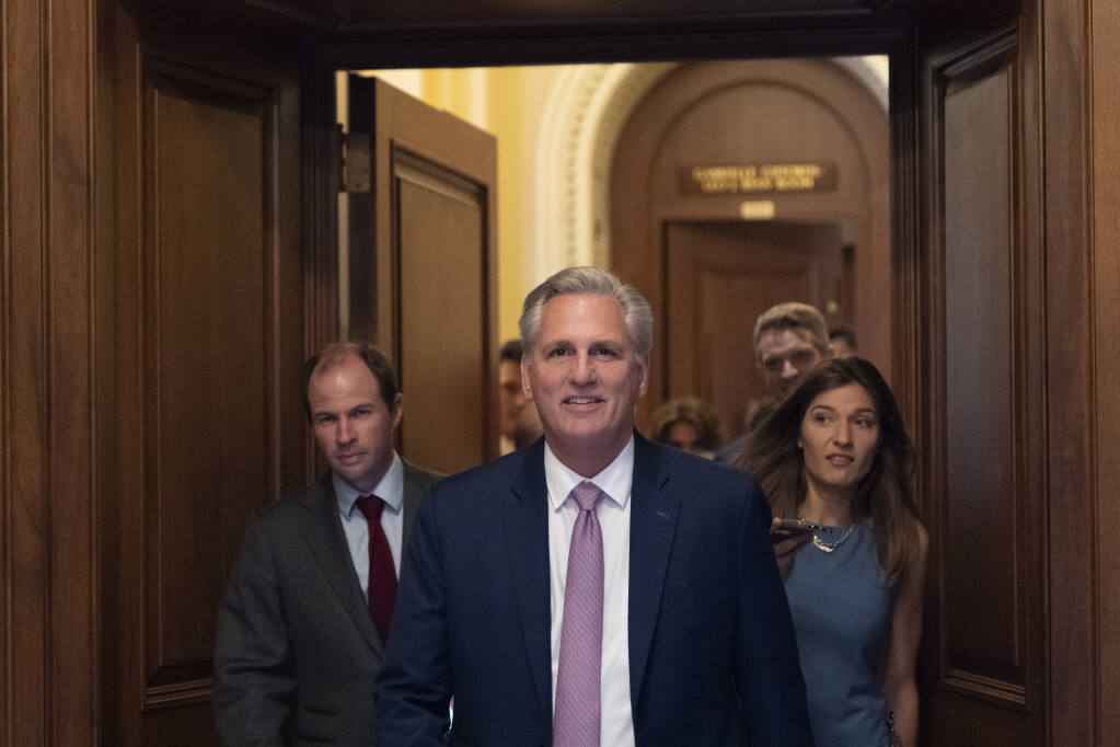 House Minority Leader Kevin McCarthy of Calif., center, leaves the floor after the House voted to create a select committee to investigate the Jan. 6 insurrection, at the Capitol in Washington, Wednesday, June 30, 2021. (AP Photo/Alex Brandon)
