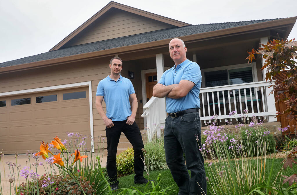 Bill Wallace, left, and Matt Everson, of BW Builder, Inc., are licensed contractors who create estimates so that fire victims can take the estimates to negotiate a better settlement with their insurance company.(Christopher Chung / The Press Democrat)