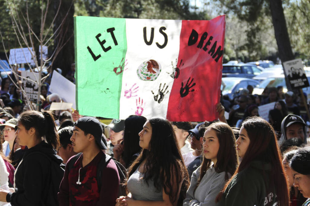 Students staged a walkout to protest the Trump Administration's immigration policies, leaving textbooks behind to march from the Santa Rosa Junior College campus to downtown Santa Rosa after the final renewal period for the defunct Deferred Action for Childhood Arrivals (DACA) program ended March 5, 2018. ( Courtesy SRJC)