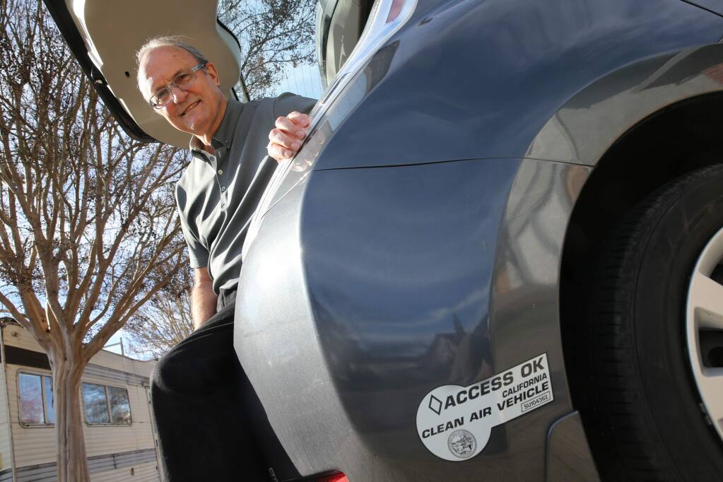 Clarence Dold, the owner of a Nissan Leaf, will no longer be able to use his clean air vehicle decal for the carpool lane. Photo taken on Wednesday, December 26, 2018 in Santa Rosa, California . (BETH SCHLANKER/The Press Democrat)