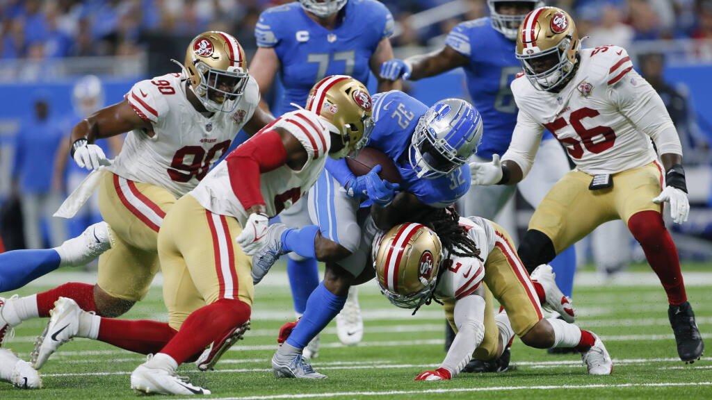 Detroit Lions running back D'Andre Swift (32) runs as San Francisco 49ers defensive back Jason Verrett (2) makes the tackle in the first half of an NFL football game in Detroit, Sunday, Sept. 12, 2021. (AP Photo/Duane Burleson)