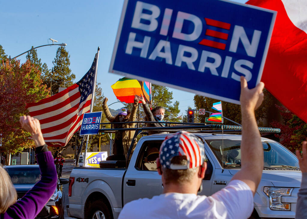 Supporters of President-elect Joe Biden and Vice President-elect Kamala Harris celebrate the Democrats' victory at Old Courthouse Square in Santa Rosa on Saturday, Nov. 7, 2020. (Alvin A.H. Jornada / The Press Democrat)