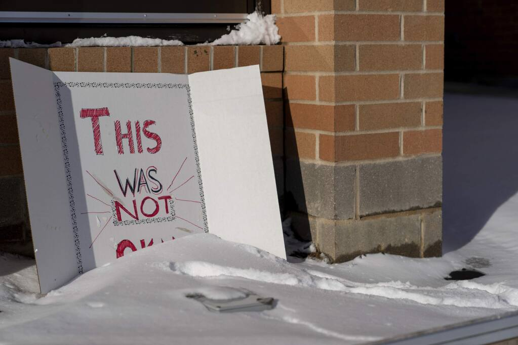 A sign reading 'This was not okay,' is seen in front of Covington Catholic High School in Park Kills, Ky., Sunday, Jan 20, 2019. A diocese in Kentucky has apologized after videos emerged showing students from the Catholic boys' high school mocking Native Americans outside the Lincoln Memorial on Friday after a rally in Washington. (AP Photo/Bryan Woolston)