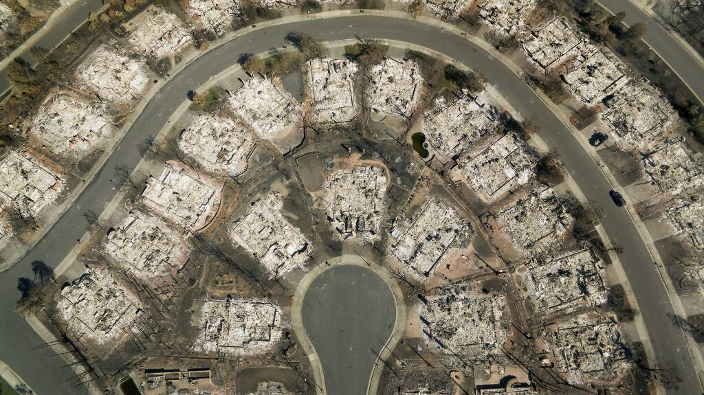Scorched Earth: An aerial view of Fountaingrove, a neighborhood of two- and three-story luxury homes that stood atop a ridge overlooking the city. It continued to smolder days after the fire, keeping the community on edge amid new forecasts for high winds. (10/25/2017)