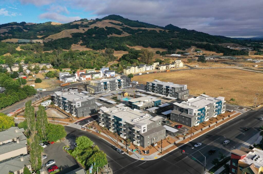 The 120-unit first phase of the 38 Degrees North apartment project at 1020 Kawana Springs Road in southeast Santa Rosa is completed in 2020. Here, it's seen from the northwest across the intersection with Petaluma Hill Road, with Taylor Mountain in the background. The vacant lot to the south is planned for the 172-unit second phase. (courtesy of Kennedy Wilson)
