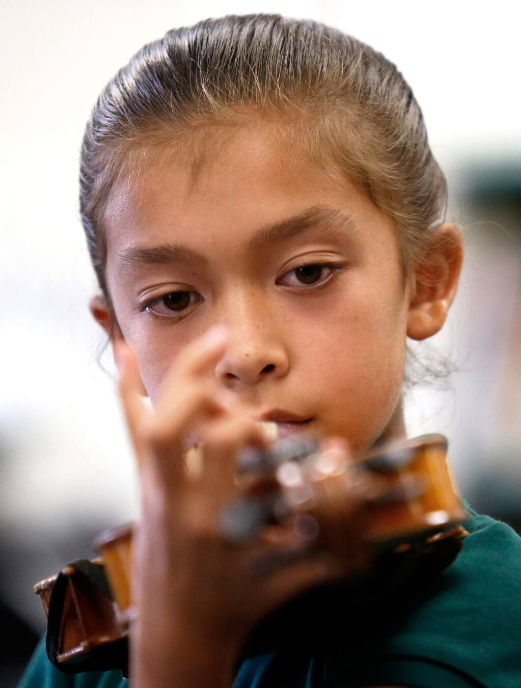 Sixth grader Sofia Santana, 10, plucks a few notes on her violin after she and her classmates received their instruments for the first time during the music blitz program at Luther Burbank Elementary School in Santa Rosa, California, on Thursday, September 13, 2018. (Alvin Jornada / The Press Democrat)